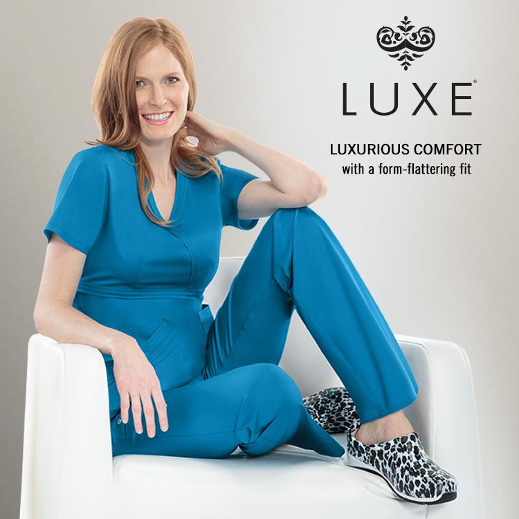 Luxe medical apparel scrubs two women model nurses purple green